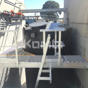 Kombi modular stair and platform systems installed around cooling tanks